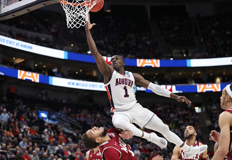 <p>Jared Harper #1 of the Auburn Tigers drives to the basket during the first half against the New Mexico State Aggies in the first round of the 2019 NCAA Men's Basketball Tournament at Vivint Smart Home Arena on March 21, 2019 in Salt Lake City, Utah. (Photo by Patrick Smith/Getty Images) </p>