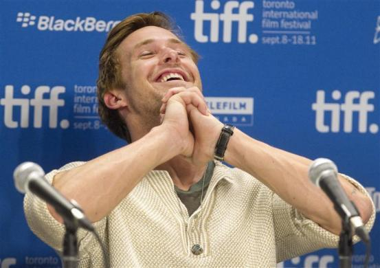 """Ryan Gosling reacts during the news conference for the film """"The Ides of March"""" at the 36th Toronto International Film Festival September 9, 2011."""