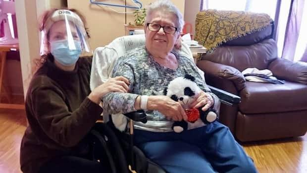 Lori, here with Joan, was able to enter her mom's room at the long-term care facility for the first time in months on Feb. 14.