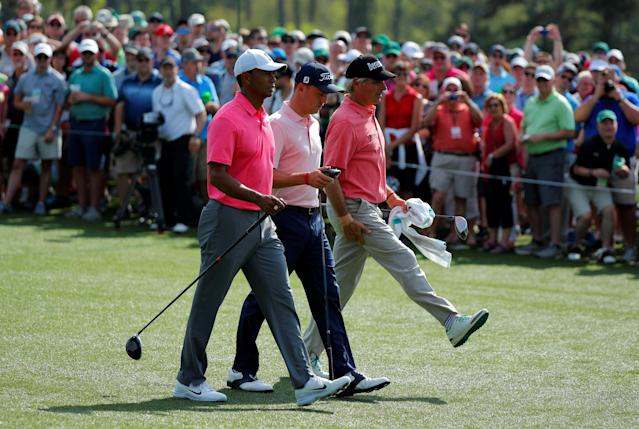 U.S. golfers Tiger Woods (L), Justin Thomas (C) and Fred Couples walk up the 8th fairway during practice for the 2018 Masters golf tournament at Augusta National Golf Club in Augusta, Georgia, U.S. April 2, 2018. REUTERS/Brian Snyder TPX IMAGES OF THE DAY