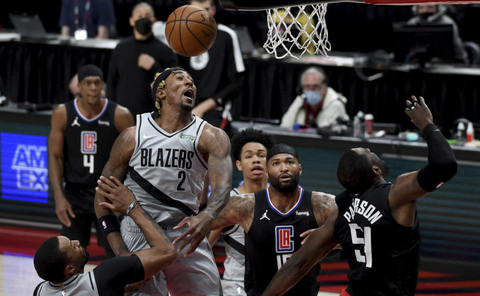 Portland Trail Blazers forward Rondae Hollis-Jefferson, left, blocks the shot of Los Angeles Clippers forward Patrick Patterson, right, during the first half of an NBA basketball game in Portland, Ore., Tuesday, April 20, 2021. (AP Photo/Steve Dykes)