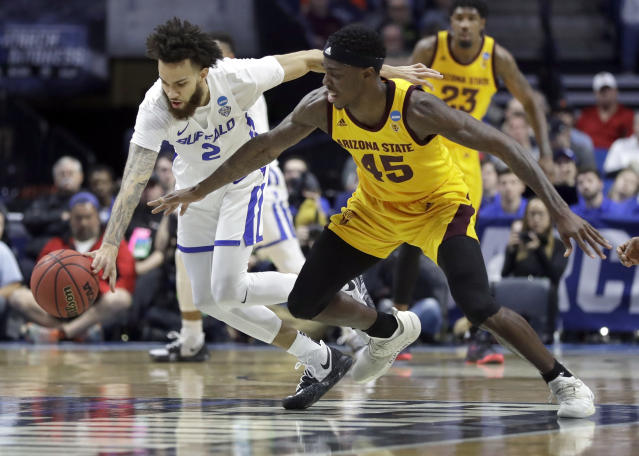 Buffalo's Jeremy Harris (2) and Arizona State's Zylan Cheatham (45) chase a loose ball during the first half of a first round men's college basketball game in the NCAA Tournament Friday, March 22, 2019, in Tulsa, Okla. (AP Photo/Jeff Roberson)