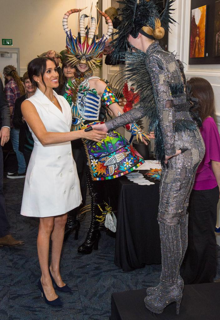 <p>It was another tuxedo dress for Meghan, as she met actors from the Courtenay Creative in Wellington on October 29. This time, the Duchess of Sussex looked to New Zealand-based designer Maggie Marilyn for the £455 ensemble.. <em>[Photo: Getty]</em> </p>