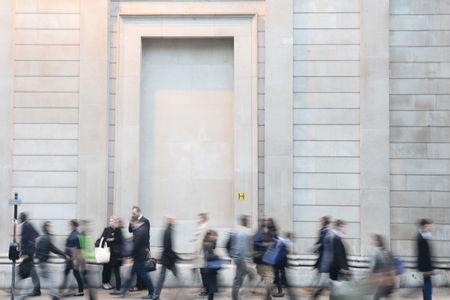 City workers make their way home past the Bank of England in the City of London, Britain October 18, 2017. Picture taken October 18, 2017. REUTERS/Mary Turner