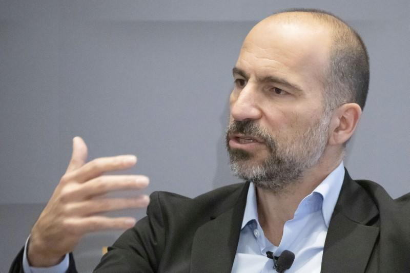 Uber CEO Dara Khosrowshahi gestures as he speaks during a meeting with the Economic Club of New York in New York City