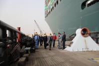 Osama Rabie, Chairman of the Suez Canal Authority, walks as he monitors the situation near stranded container ship Ever Given, one of the world's largest container ships, after it ran aground, in Suez Canal