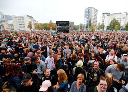 "People gather before an open air ""anti-racism concert"" in Chemnitz, Germany, September 3, 2018. REUTERS/Hannibal Hanschke"