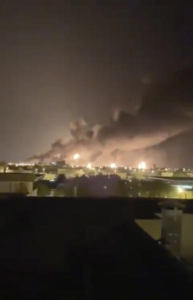 Smoke fills the sky at the Abqaiq oil processing facility on Saturday, Sept. 14, 2019 in Saudi Arabia.   Drones claimed by Yemen's Houthi rebels attacked the world's largest oil processing facility in Saudi Arabia and a major oilfield operated by Saudi Aramco early Saturday, sparking a huge fire at a processor crucial to global energy supplies.  (Validated UGC via AP)