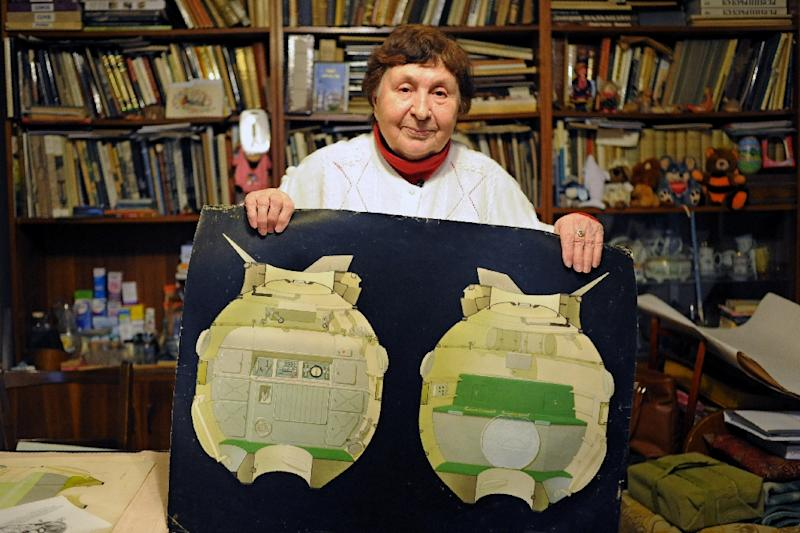 Galina Balashova, the artist who designed the first space habitation module for Soviet cosmonauts, shows drawings of her work in the city of Korolyov outside Moscow