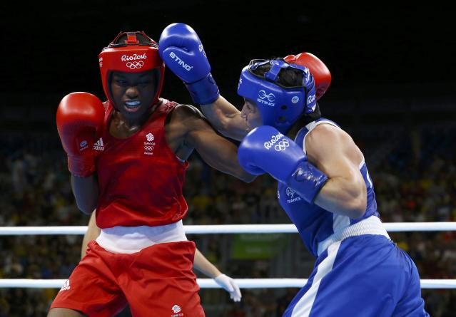 2016 Rio Olympics - Boxing - Final - Women's Fly (51kg) Final Bout 267 - Riocentro - Pavilion 6 - Rio de Janeiro, Brazil - 20/08/2016. Nicola Adams (GBR) of Britain and Sarah Ourahmoune (FRA) of France compete. REUTERS/Peter Cziborra FOR EDITORIAL USE ONLY. NOT FOR SALE FOR MARKETING OR ADVERTISING CAMPAIGNS.