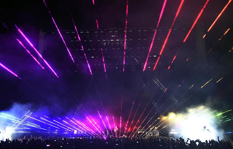 Lasers are projected onstage during Roger Waters' closing performance on day 3 of the 2016 Desert Trip music festival at Empire Polo Field on Sunday, Oct. 9, 2016, in Indio, Calif. (Photo by Chris Pizzello/Invision/AP)