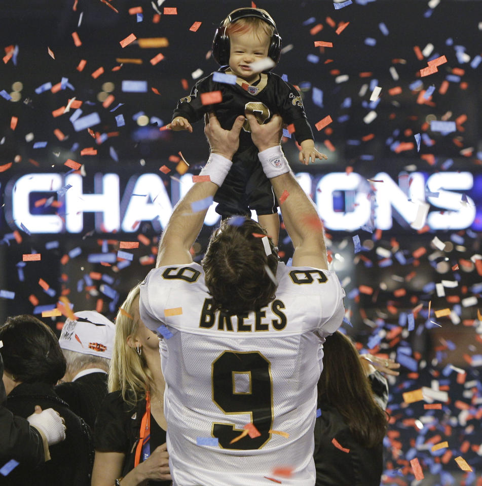 FILE - This Feb. 7, 2010, file photo shows New Orleans Saints quarterback Drew Brees holding his son, Baylen, after the NFL Super Bowl XLIV football game against the Indianapolis Colts, in Miami. Brees was voted the 2010 Male Athlete of the Year, chosen by members of The Associated Press, Friday, Dec. 17, 2010.