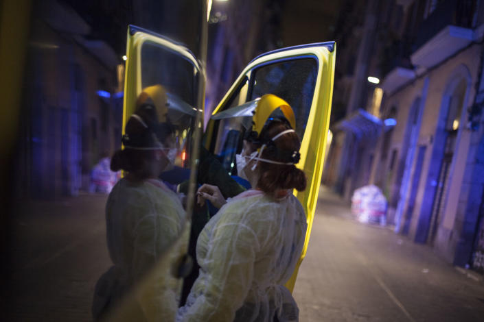 The medical team of an ambulance is prepared with the special anti-contagion suits, to go to treat an elderly person and take her to the emergency room. Barcelona, Spain, Thursday, March 19, 2020. (José Colon for Yahoo News)
