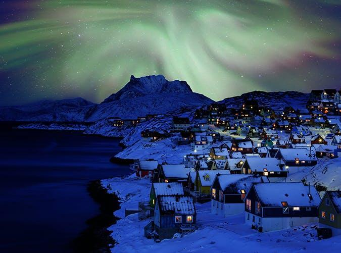 <p>Humpback whales! Fjords! Icebergs! The northern lights! Those are just a few of the things you'll find in Greenland's tiny capital city. The waterfront, made up of brightly painted houses, is the perfect contrast to the freezing arctic weather.</p>