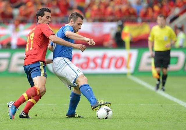 Italian forward Antonio Cassano (R) fights for the ball with Spanish defender Alvaro Arbeloa during the Euro 2012 championships football match Spain vs Italy on June 10, 2012 at the Gdansk Arena. AFP PHOTO / CHRISTOF STACHECHRISTOF STACHE/AFP/GettyImages