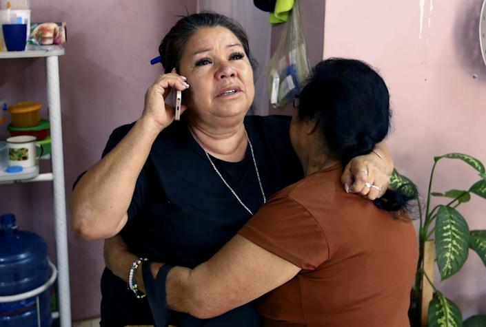 "Rosa Alba Santoyo Soria is comforted by a friend. <span class=""copyright"">(Eduardo Verdugo / Associated Press)</span>"