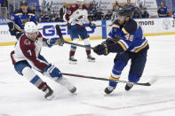 Colorado Avalanche's Devon Toews (7) attempts to block a shot from St. Louis Blues' Jake Walman (46) during the second period of an NHL hockey game on Wednesday, April 14, 2021, in St. Louis. (AP Photo/Joe Puetz)