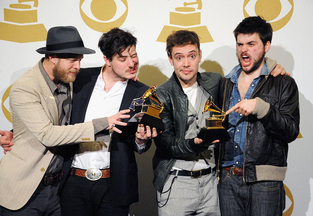 "Ted Dwayne, Marcus Mumford, Ben Lovett and ""Country"" Winston Marshall of Mumford and Sons pose in the press room during the 55th Annual GRAMMY Awards at STAPLES Center on February 10, 2013 in Los Angeles, California."