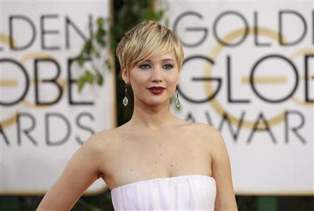 Actress Jennifer Lawrence arrives at the 71st annual Golden Globe Awards in Beverly Hills