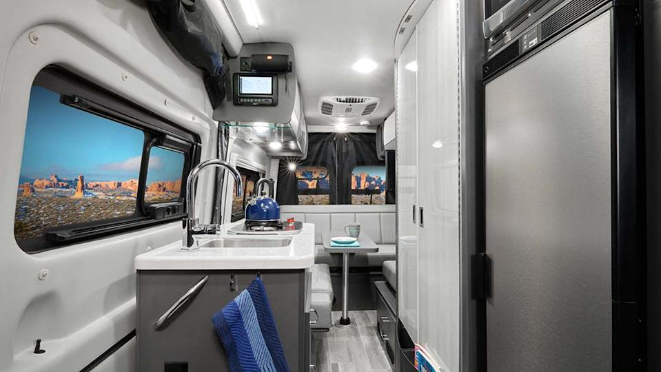 The Sanctuary camper features a kitchenette, bathroom and a bed for two. - Credit: Rob Perisho/Thor Motor Coach