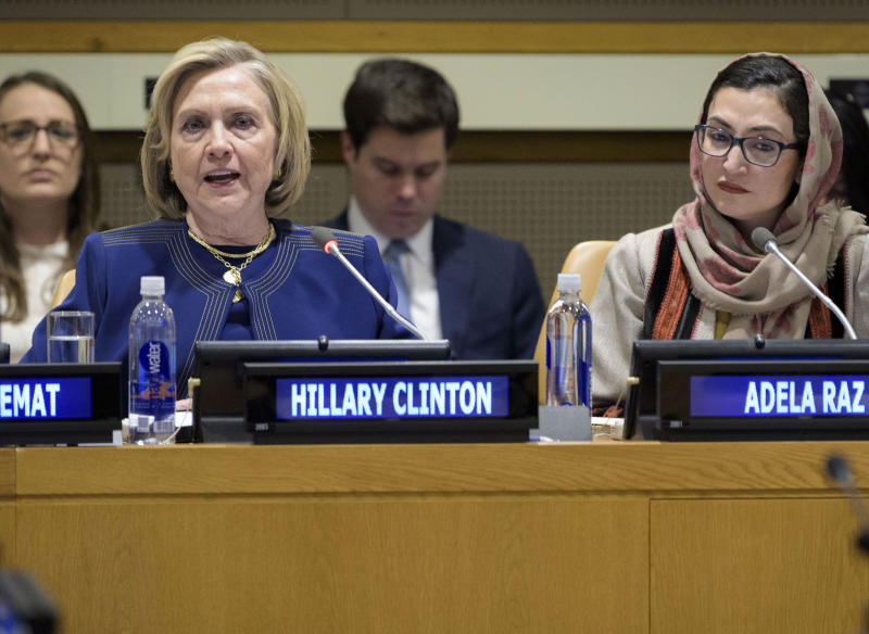 """In this photo provided by the United Nations, former U.S. Secretary of State Hillary Clinton, foreground left, delivers the keynote speech at an event entitled """"Group of Friends of Afghanistan,"""" Tuesday, March 10, 2020, at United Nations headquarters. The event was organized by the Permanent Mission of Afghanistan to the United Nations. (Manuel Elias/The United Nations via AP)"""
