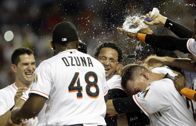 Miami Marlins' Henderson Alvarez, center, celebrates with teammates after pitching a no-hitter asgainst the Detroit Tigers after an interleague baseball game, Sunday, Sept. 29, 2013, in Miami. The Marlins won 1-0. (AP Photo/Alan Diaz)