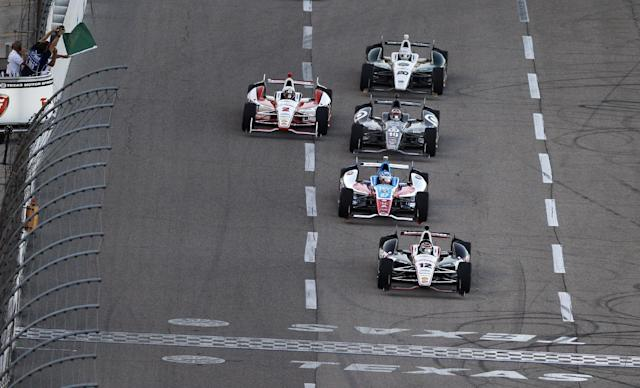 Will Power (12) takes the green flag in front of Josef Newgarden (67), Tony Kanaan (10), Juan Pablo Montoya (2) and Ed Carpenter (20) at the start of an IndyCar auto race at Texas Motor Speedway in Fort Worth, Texas, Saturday, June 7, 2014. (AP Photo/Ralph Lauer)