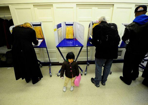 PHOTO: New York residents cast their vote in the mid-term elections at a polling station at a school in New York, Nov. 2, 2010. (AFP via Getty Images, FILE)