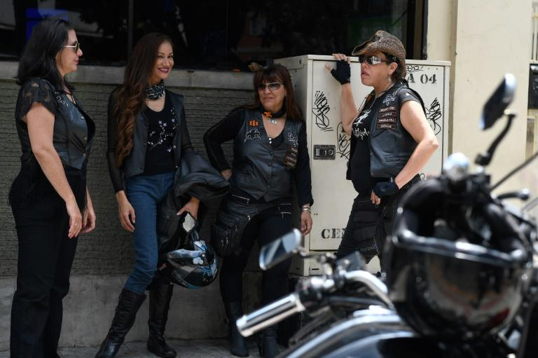 "Members of female motorcycle club ""Rat Girls"" gather outside a bar in Caracas"