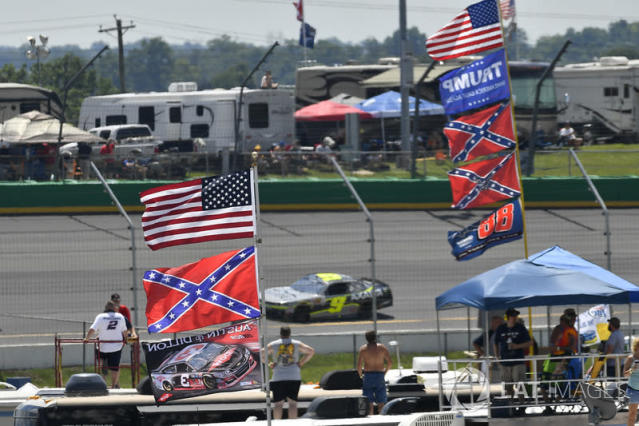 """A general view of campers and flags in the infield <span class=""""copyright"""">Logan Whitton / NKP / Motorsport Images</span>"""