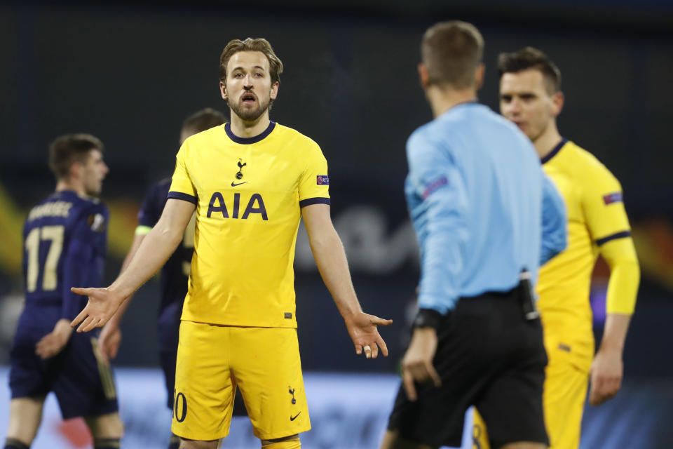Tottenham's Harry Kane, left, reacts to the referee Davide Massa during the Europa League round of 16 second leg soccer match between Dinamo Zagreb and Tottenham Hotspur at the Maksimir stadium in Zagreb, Croatia, March 18, 2021. (AP Photo/Darko Bandic)