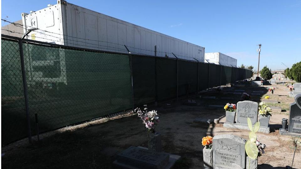 Cemetery next to El Paso Medical Examiner's office where mobile morgues are set up