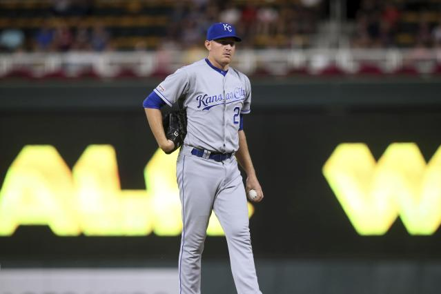 Kansas City Royals pitcher Mike Montgomery reacts after giving up a walk to Minnesota Twins' Luis Arraez duirng the second inning of a baseball game Thursday, Sept. 19, 2019, in Minneapolis. (AP Photo/Jim Mone)