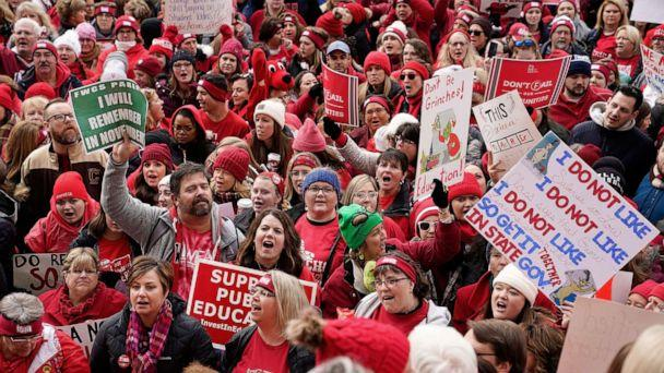 PHOTO: Educators and their supporters gather as teachers hold a one day walkout at the statehouse in Indianapolis, Nov. 19, 2019. (Bryan Woolston/Reuters)