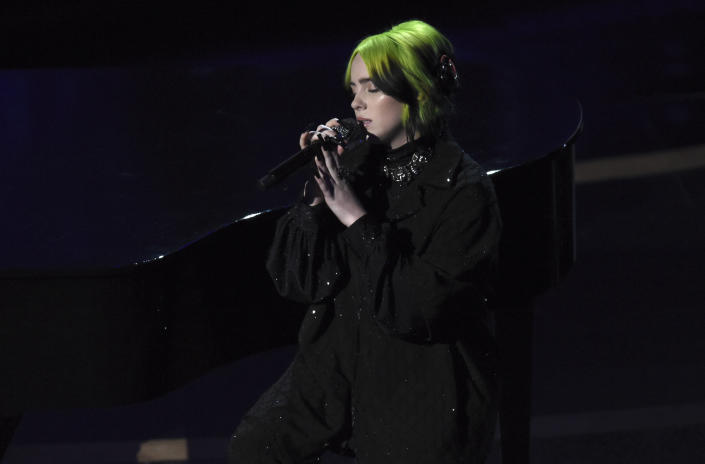 Billie Eilish performs during the in memoriam tribute at the Oscars on Sunday, Feb. 9, 2020, at the Dolby Theatre in Los Angeles. (AP Photo/Chris Pizzello)