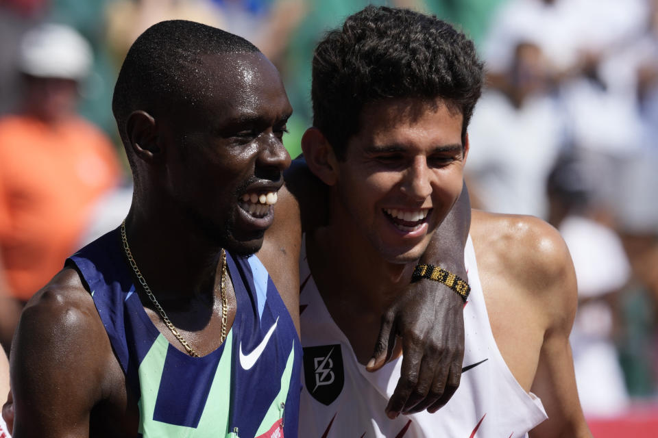 Paul Chelimo, left, celebrates with Grant Fisher after winning the finals of men's 5000-meter run at the U.S. Olympic Track and Field Trials Sunday, June 27, 2021, in Eugene, Ore. (AP Photo/Ashley Landis)