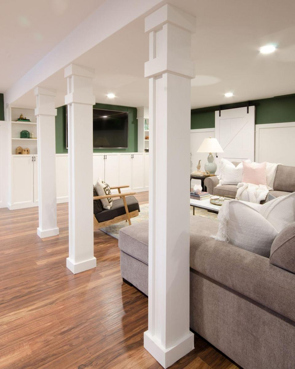 """<p>Say goodbye to unsightly basement support poles with this tutorial for beautiful white wood columns. Add to the regal appeal with rich, green walls. </p><p><strong>See more at <a href=""""https://www.thechroniclesofhome.com/2018/03/how-to-turn-support-poles-into-columns.html?utm_term=basement%20ideas"""" rel=""""nofollow noopener"""" target=""""_blank"""" data-ylk=""""slk:The Chronicles of Home"""" class=""""link rapid-noclick-resp"""">The Chronicles of Home</a>.</strong></p><p><a class=""""link rapid-noclick-resp"""" href=""""https://go.redirectingat.com?id=74968X1596630&url=https%3A%2F%2Fwww.walmart.com%2Fip%2FALEX-PLUS-All-Purpose-Acrylic-Latex-Caulk-Plus-Silicone-White-10-1-oz%2F17243994&sref=https%3A%2F%2Fwww.redbookmag.com%2Fhome%2Fg36061437%2Fbasement-ideas%2F"""" rel=""""nofollow noopener"""" target=""""_blank"""" data-ylk=""""slk:SHOP CAULK"""">SHOP CAULK</a></p>"""