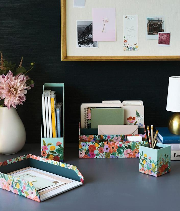 "<p>""I believe in finding beauty in the everyday. I suggest looking for desk organizers and accessories that you love. Beautiful items like <a href=""https://urldefense.com/v3/__https:/riflepaperco.com/strawberry-fields-magazine-holder__;!!Ivohdkk!xJIBaQlNvoaK9AcNSn7SUbXQliKOyBs3USMMbSek_SE8pKnDzx1VU13Tb_k5R71bVQ$"" rel=""nofollow noopener"" target=""_blank"" data-ylk=""slk:magazine holders"" class=""link rapid-noclick-resp"">magazine holders</a>, <a href=""https://urldefense.com/v3/__https:/riflepaperco.com/strawberry-fields-assorted-file-folders__;!!Ivohdkk!xJIBaQlNvoaK9AcNSn7SUbXQliKOyBs3USMMbSek_SE8pKnDzx1VU13Tb_nEB6awbA$"" rel=""nofollow noopener"" target=""_blank"" data-ylk=""slk:file folders"" class=""link rapid-noclick-resp"">file folders</a>, <a href=""https://urldefense.com/v3/__https:/riflepaperco.com/garden-party-pencil-cup__;!!Ivohdkk!xJIBaQlNvoaK9AcNSn7SUbXQliKOyBs3USMMbSek_SE8pKnDzx1VU13Tb_nUlw6D9A$"" rel=""nofollow noopener"" target=""_blank"" data-ylk=""slk:pencil cups"" class=""link rapid-noclick-resp"">pencil cups </a>and <a href=""https://urldefense.com/v3/__https:/riflepaperco.com/desk-planners/notebooks__;!!Ivohdkk!xJIBaQlNvoaK9AcNSn7SUbXQliKOyBs3USMMbSek_SE8pKnDzx1VU13Tb_klDR2GMQ$"" rel=""nofollow noopener"" target=""_blank"" data-ylk=""slk:notebooks"" class=""link rapid-noclick-resp"">notebooks</a> often make me excited to get organized. Plus, desk accessories are a fun and easy way to refresh a space. </p><p>""It's important to find the right organizational tools. Sometimes that looks like a <a href=""https://urldefense.com/v3/__https:/riflepaperco.com/luisa-large-memo-notepad__;!!Ivohdkk!xJIBaQlNvoaK9AcNSn7SUbXQliKOyBs3USMMbSek_SE8pKnDzx1VU13Tb_l7A7enGw$"" rel=""nofollow noopener"" target=""_blank"" data-ylk=""slk:blank notepad"" class=""link rapid-noclick-resp"">blank notepad</a> to sketch ideas, a <a href=""https://urldefense.com/v3/__https:/riflepaperco.com/colette-spiral-notebook__;!!Ivohdkk!xJIBaQlNvoaK9AcNSn7SUbXQliKOyBs3USMMbSek_SE8pKnDzx1VU13Tb_l77FsPvA$"" rel=""nofollow noopener"" target=""_blank"" data-ylk=""slk:spiral notebook"" class=""link rapid-noclick-resp"">spiral notebook</a> to jot down meeting notes and next steps, or a <a href=""https://urldefense.com/v3/__https:/riflepaperco.com/you-got-this-checklist-notepad__;!!Ivohdkk!xJIBaQlNvoaK9AcNSn7SUbXQliKOyBs3USMMbSek_SE8pKnDzx1VU13Tb_kORinZcg$"" rel=""nofollow noopener"" target=""_blank"" data-ylk=""slk:notepad with a checklist"" class=""link rapid-noclick-resp"">notepad with a checklist</a> for easy to-do's. Organization doesn't look the same for everyone and it can be fun to find what works best for you."" — Anna Rifle Bond, c0-founder and CCO of <a href=""https://riflepaperco.com/"" rel=""nofollow noopener"" target=""_blank"" data-ylk=""slk:Rifle Paper Co."" class=""link rapid-noclick-resp"">Rifle Paper Co.</a></p>"