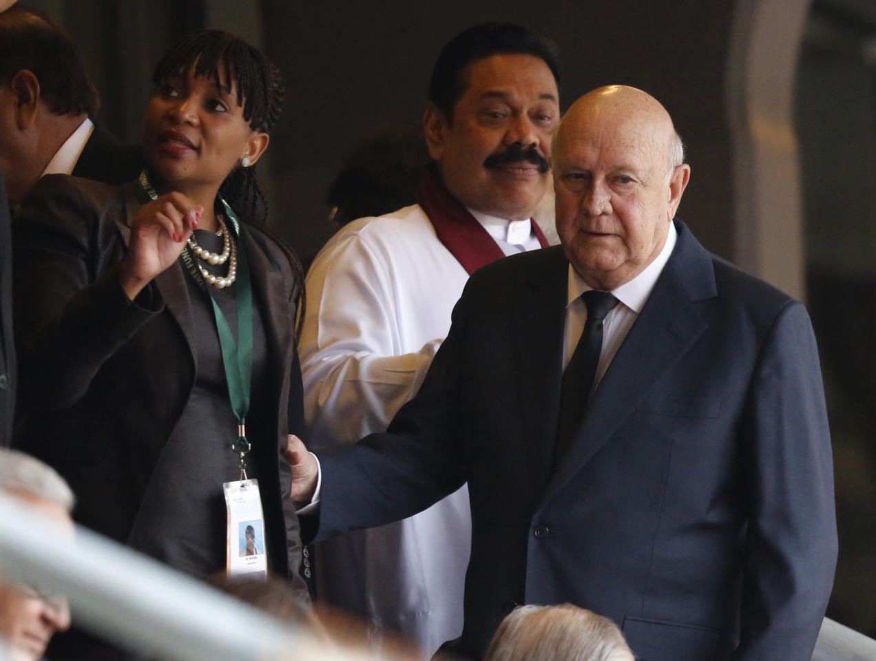 Former South African President F. W. De Klerk, right, arrives for the memorial service for former South African president Nelson Mandela at the FNB Stadium in Soweto near Johannesburg, Tuesday, Dec. 10, 2013. (AP Photo/Ben Curtis)