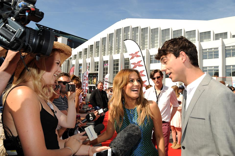 Caroline Flack and Matt Richardson pictured arriving at Wembley Arena for the X Factor auditions on July 15, 2013 in London, England. (Photo by SAV/FilmMagic)
