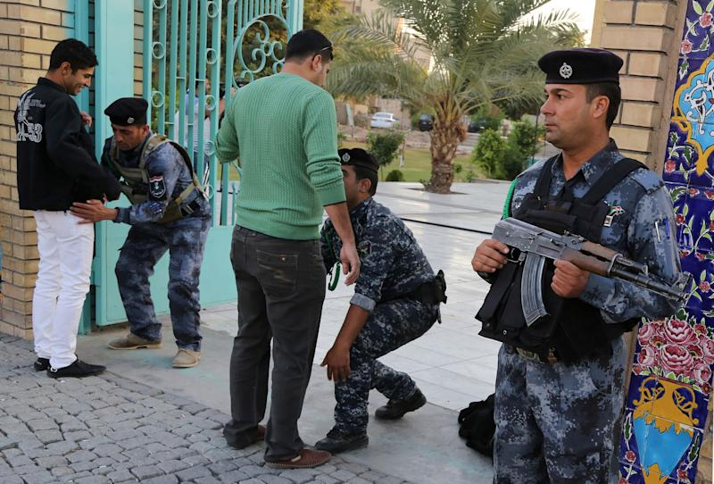 Iraqi security forces search worshipers outside a Sunni mosque on the first day of Eid al-Adha in Baghdad, Iraq, Tuesday, Oct. 15, 2013. Muslims worldwide are celebrating Eid al-Adha, or the Feast of the Sacrifice, by sacrificial killing of sheep, goats, cows or camels. The slaughter commemorates the biblical story of Abraham, who was on the verge of sacrificing his son to obey God's command, when God interceded by substituting a ram in the child's place. (AP Photo/Karim Kadim)