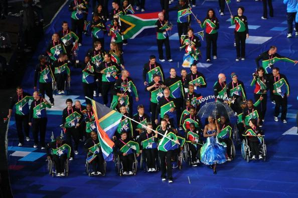 LONDON, ENGLAND - AUGUST 29: Athlete Oscar Pistorius of South Africa carries the flag during the Opening Ceremony of the London 2012 Paralympics at the Olympic Stadium on August 29, 2012 in London, England. (Photo by Mike Ehrmann/Getty Images)