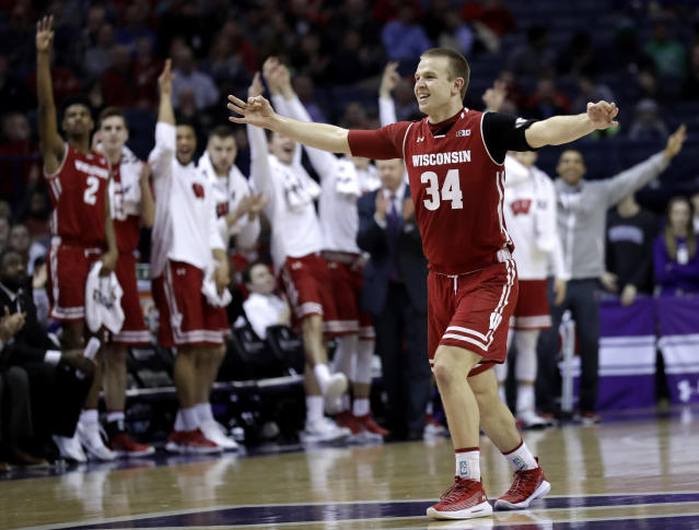 "Wisconsin guard Brad Davison(34) celebrates after forward <a class=""link rapid-noclick-resp"" href=""/ncaab/players/131283/"" data-ylk=""slk:Andy Van Vliet"">Andy Van Vliet</a> made a three-point basket Northwestern during the first half of an NCAA college basketball game Thursday, Feb. 22, 2018, in Rosemont, Ill. (AP Photo/Nam Y. Huh)"