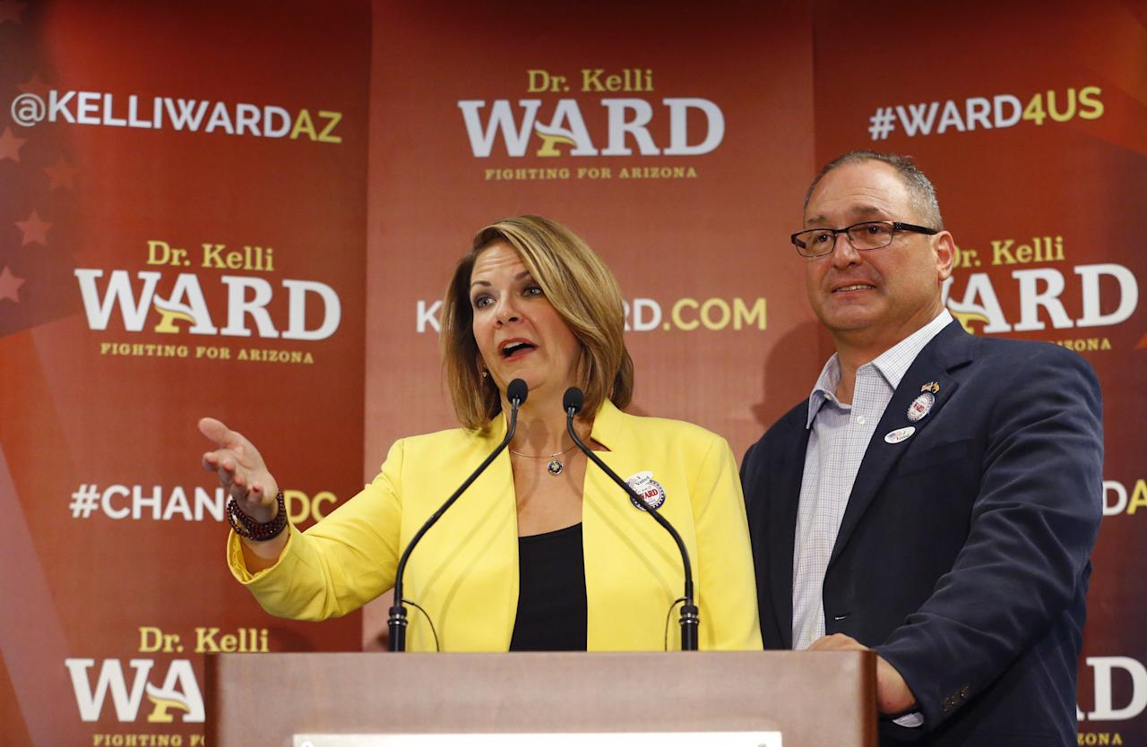 Kelli Ward with her husband Mike at her side concedes to Sen. John McCain, R-Ariz. in the race for the Republican nomination to U.S. Senate, at her primary night party at a hotel in Scottsdale, Ariz., Tuesday, Aug. 30, 2016. McCain easily defeated former state Sen. Ward and two other Republicans. (David Kadlubowski/The Arizona Republic via AP)
