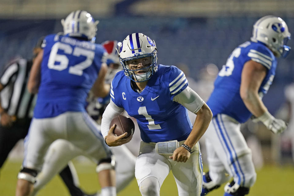 BYU quarterback Zach Wilson (1) carries the ball before scoring against Louisiana Tech during the second half on Oct. 2. (AP)
