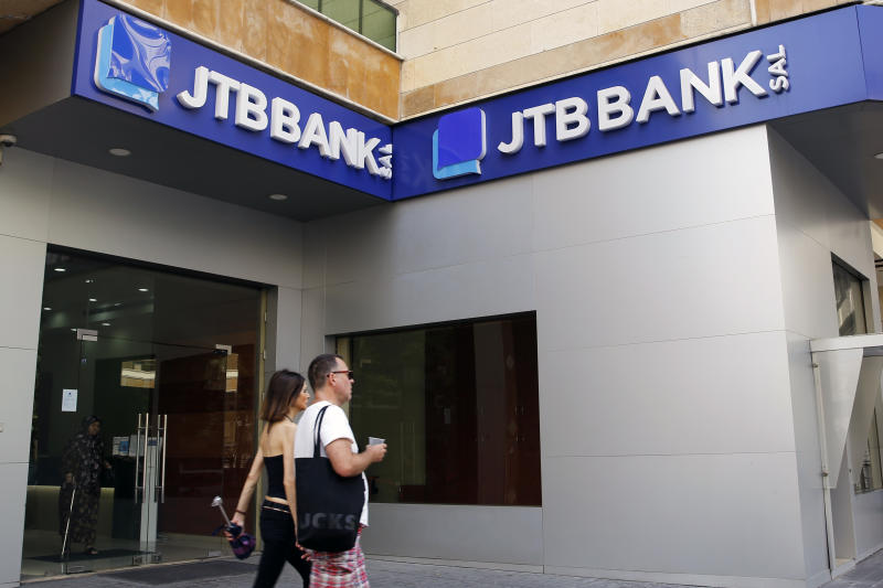 """FILE - This August 30, 2019 file photo, shows a branch of the Jammal Trust Bank which is being targeted by the U.S. Department of the Treasury for """"knowingly facilitating banking activities"""" for the militant Hezbollah group, in Beirut, Lebanon. The Jammal Trust Bank has denied the charges, saying it abides by international laws. The Trump administration has been imposing sanctions on Hezbollah and institutions linked to it at an unprecedented rate in recent months, targeting lawmakers in Lebanon's parliament for the first time, as well as the local Jammal Trust Bank. (AP Photo/Bilal Hussein, File)"""