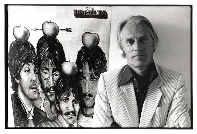 <p>George Martin, the British producer credited with discovering The Beatles–he signed them to a contract after every other label had turned them away–died at 90 on March 8. — (Pictured) George Martin poses with poster of Beatles in 1984. (Rob Verhorst/Redferns via Getty Images) </p>