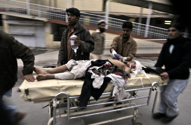 A Pakistani youth, who was injured in a suicide bombing is rushed to a hospital in Peshawar, Pakistan, Friday, Feb. 1, 2013. A suicide bomber detonated his explosives outside a Shiite mosque in northwestern Pakistan as worshippers were leaving Friday prayers, killing several people and wounding dozens in the latest apparent sectarian attack in the country, police said.(AP Photo/Mohammad Sajjad)