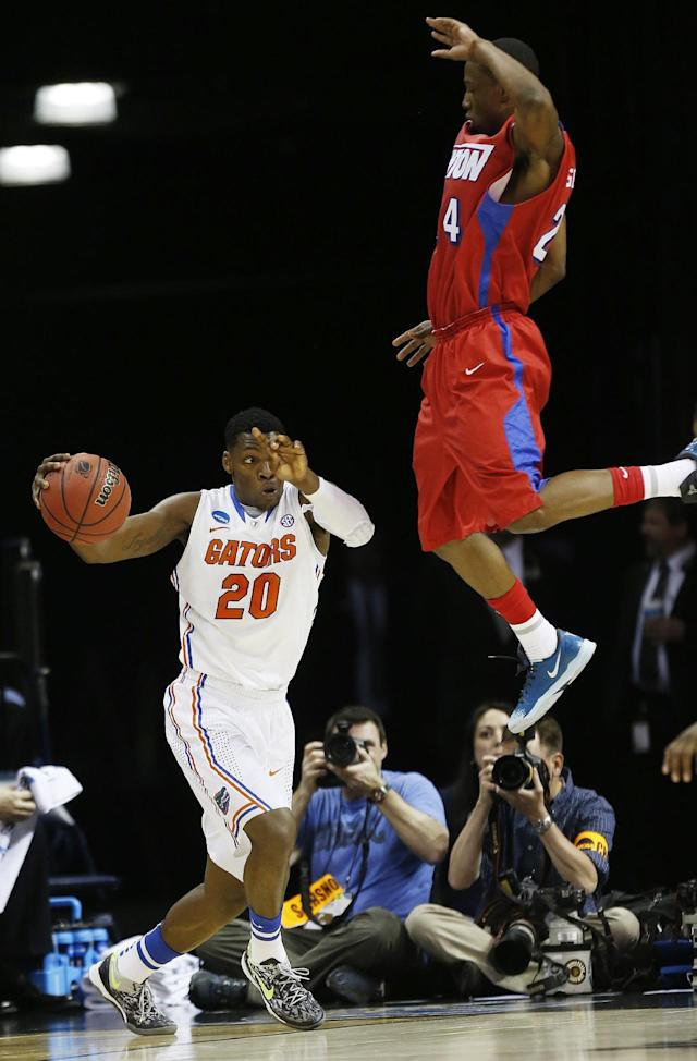 Florida guard Michael Frazier II (20) moves the ball by Dayton guard Jordan Sibert (24) during the first half in a regional final game at the NCAA college basketball tournament, Saturday, March 29, 2014, in Memphis, Tenn. (AP Photo/John Bazemore)