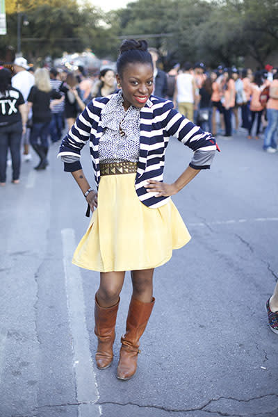Preppy cowgirl - We love that this girl added a touch of nautical flair to an otherwise country-tinged outfit. Her navy-striped blazer and yellow circle skirt are toughened up by a studded belt and lived-in boots that would look at home on the range.